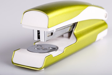 Light green stapler isolated on white