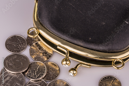 Black vintage wallet and coins isolated on white
