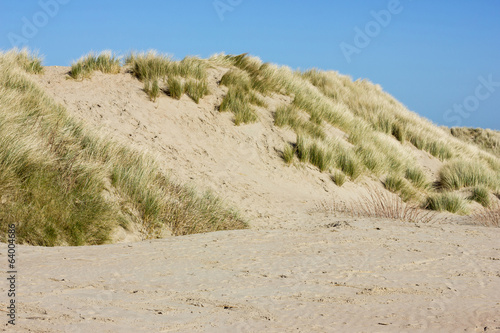 Sandy dunes on a blue sky