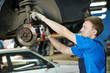 auto mechanic at car brake shoes replacement