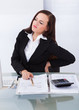 Tax Consultant Suffering From Backache At Desk