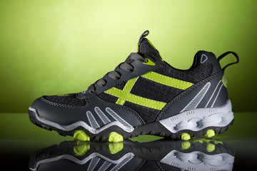 new sport shoe on a green background