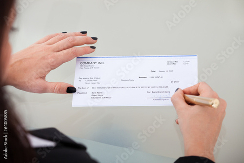 Businesswoman Signing Cheque