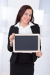 Businesswoman Holding Blank Chalkboard