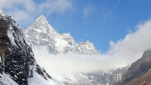 Movement of the clouds on the mountains Cho Oyu, Himalayas,