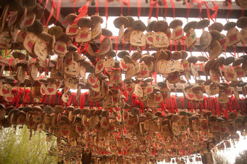 Wood of love hanging on pole in Historical Shuhe ancient town.