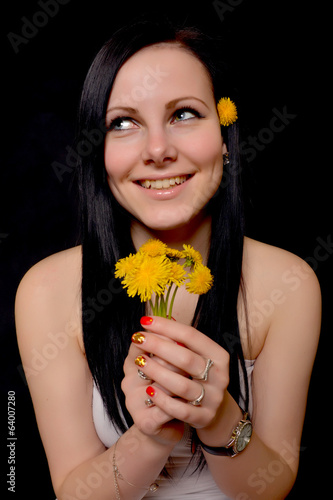 woman with dandelion isolated on black