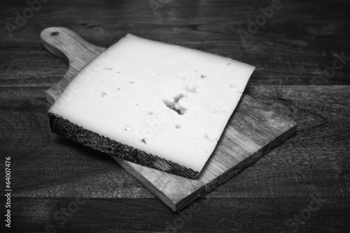 Italy, Asiago italian cheese on a wooden table