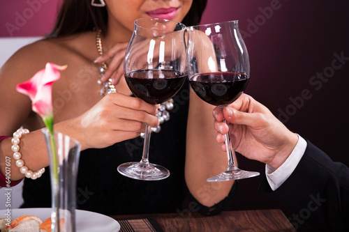 Couple Toasting Wineglasses In Restaurant