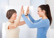 Caregiver And Senior Woman Giving High Five