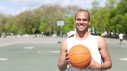 Portrait of basketball player smiling to camera