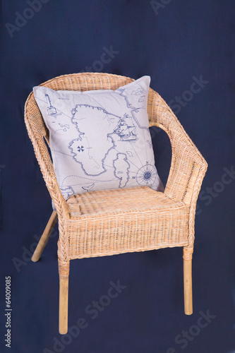 Wooden wicker chair with cushion with map