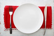 Leinwanddruck Bild - White plate with fork and knife