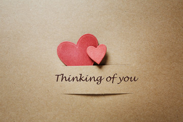 Thinking of you message with red paper hearts