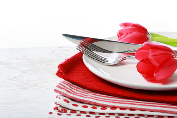 Dishware with red tulips