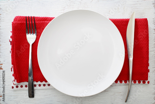 Leinwanddruck Bild White plate with fork and knife
