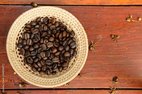 coffee beans in basket on the wooden background
