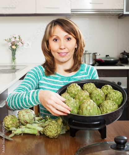 Ordinary woman cooking artichoke