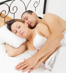 adult couple sleeping together