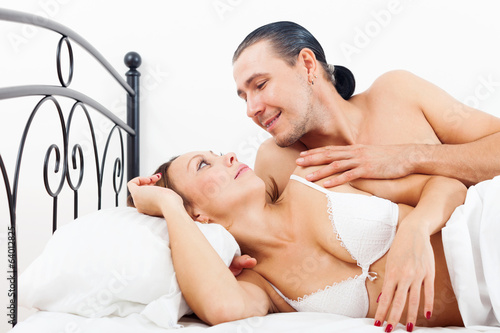 Loving middle-aged couple awaking together
