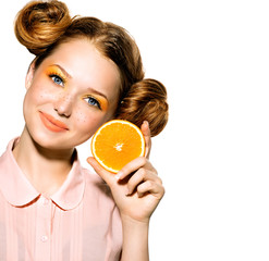 Beauty Model Girl with Juicy Orange. Joyful Teen Girl