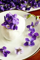 Homemade ice cream decorated violets flowers