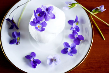 Ice cream decorated violets flowers