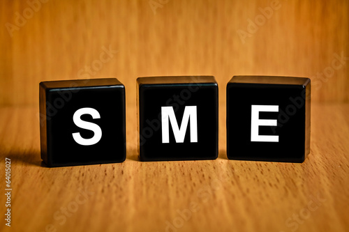 SME or Small and medium enterprises word on black block