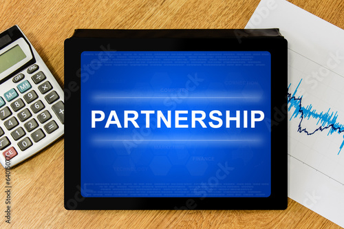 partnership word on digital tablet