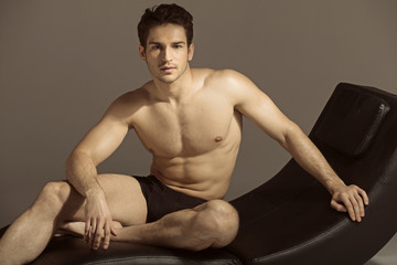 Brunette man relaxing after gym