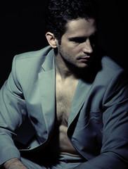 Serious muscular man wearing suit