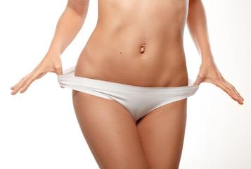 Beautiful female body isolated over white background.