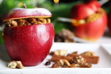 Stuffed Christmas apples with nuts and raisins on table close