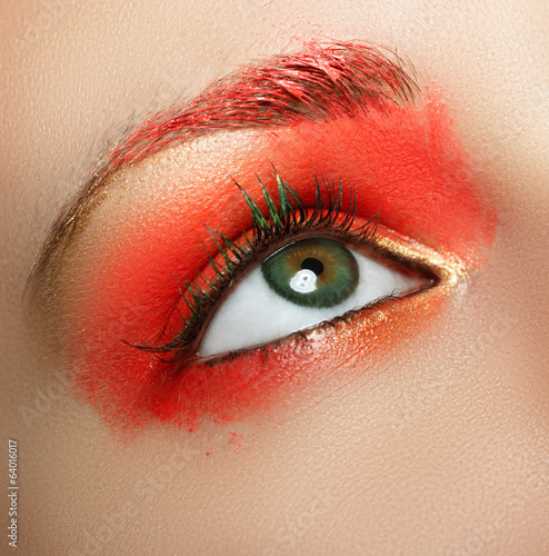 Closeup female eye with beautiful fashion bright makeup.