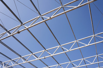Iron construction detail against clear blue sky