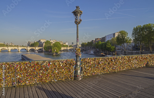 Railing of the bridge, completely hung with locks of love.
