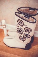 pair of woolen felt boots on white background