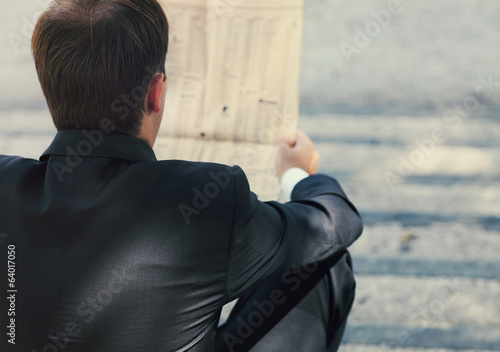 Businessman with a newspaper