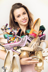 Portrait of the woman with plenty of shoes