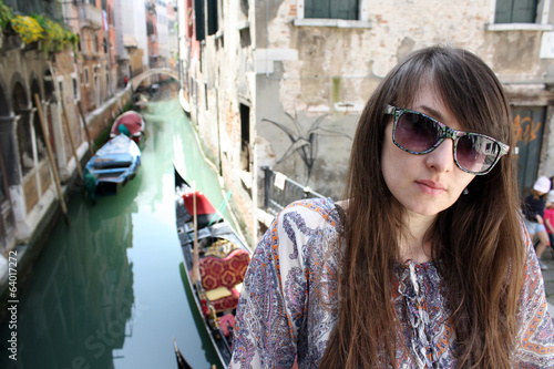 Young beautiful girl on a street in Venice