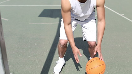 Portrait of Basketball player bouncing the ball