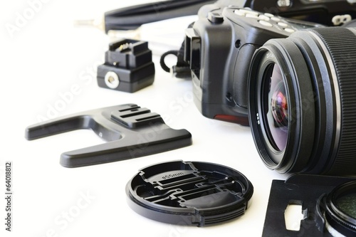 The lens is surrounded by other equipment to take pictures