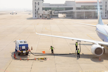 Airplane in airport serviced by the ground crew