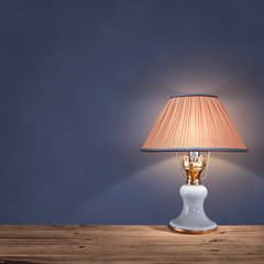 vintage table lamp on blue background
