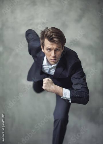 Conceptual photo of handsome businessman starting his career
