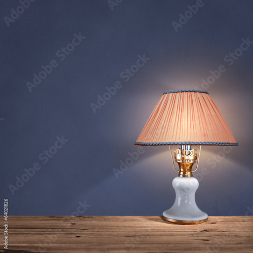 vintage table lamp on blue background