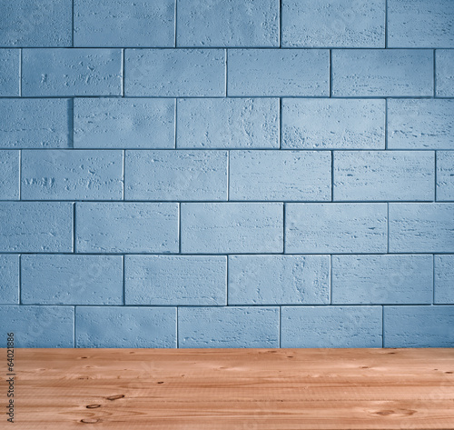 blue brick background and wooden floor