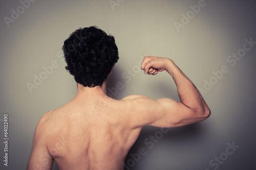 Rear view of athletic young man