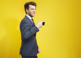Cheerful businessman during the coffee break
