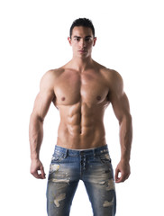 Frontal shot of shirtless muscular young man in jeans
